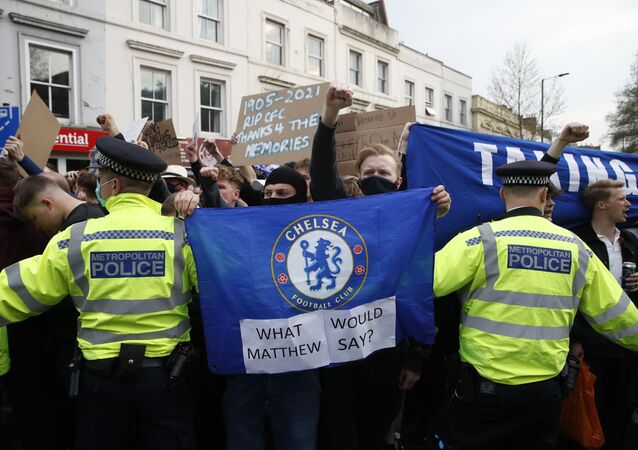 Soccer Football - Premier League - Chelsea v Brighton & Hove Albion - Stamford Bridge, London, Britain - April 20, 2021 Police officers are seen as Chelsea fans protest the planned European Super League outside the stadium before the match. It was announced twelve of Europe's top football clubs will launch a breakaway