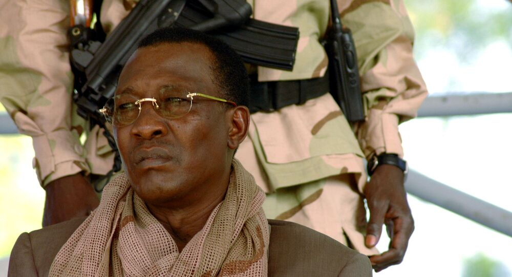 FILE PHOTO: Chad President Idriss Deby watches a rally in N'Djamena April 15, 2006. Deby's supporters paraded victoriously through the streets of the capital N'Djamena on Saturday but many nervous residents feared rebels fighting to topple him may return.