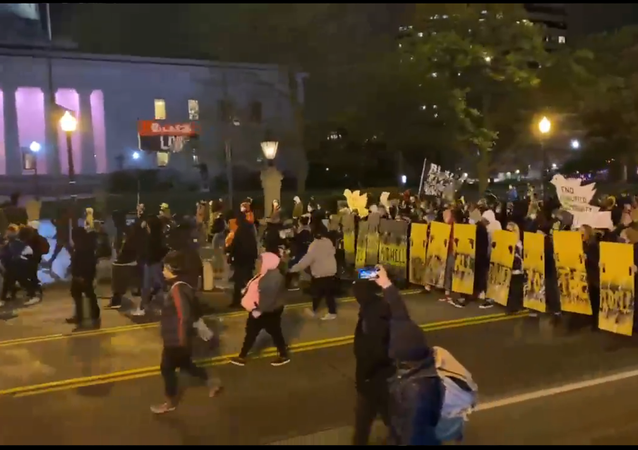A screenshot from footage of demonstrators marching in Columbus, Ohio.