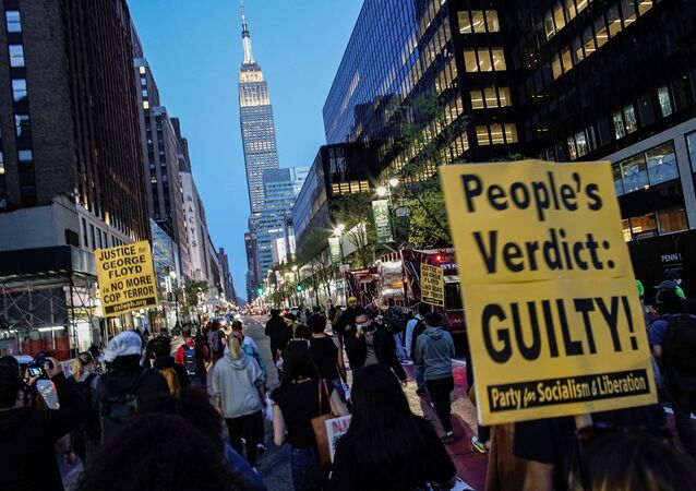 People march with signs on a street after the verdict in the trial of former Minneapolis police officer Derek Chauvin, found guilty of the death of George Floyd, in New York City, New York, U.S., April 20, 2021