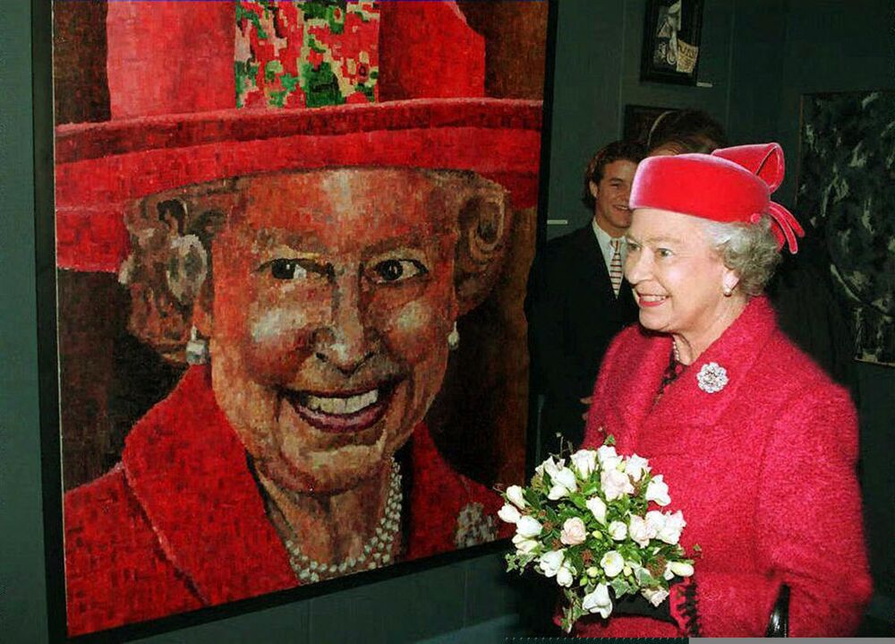 The Queen admires her portrait painted by sixth former Peter Hawkins (pictured), during a visit with the Duke of Edinburgh to Radley College, Abingdon, Oxon, to open a new building.