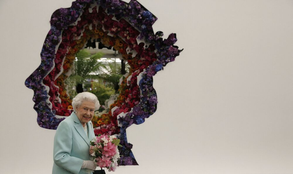 Queen Elizabeth II is pictured next to a floral exhibit by the New Covent Garden Flower Market at the 2016 Chelsea Flower Show in central London.