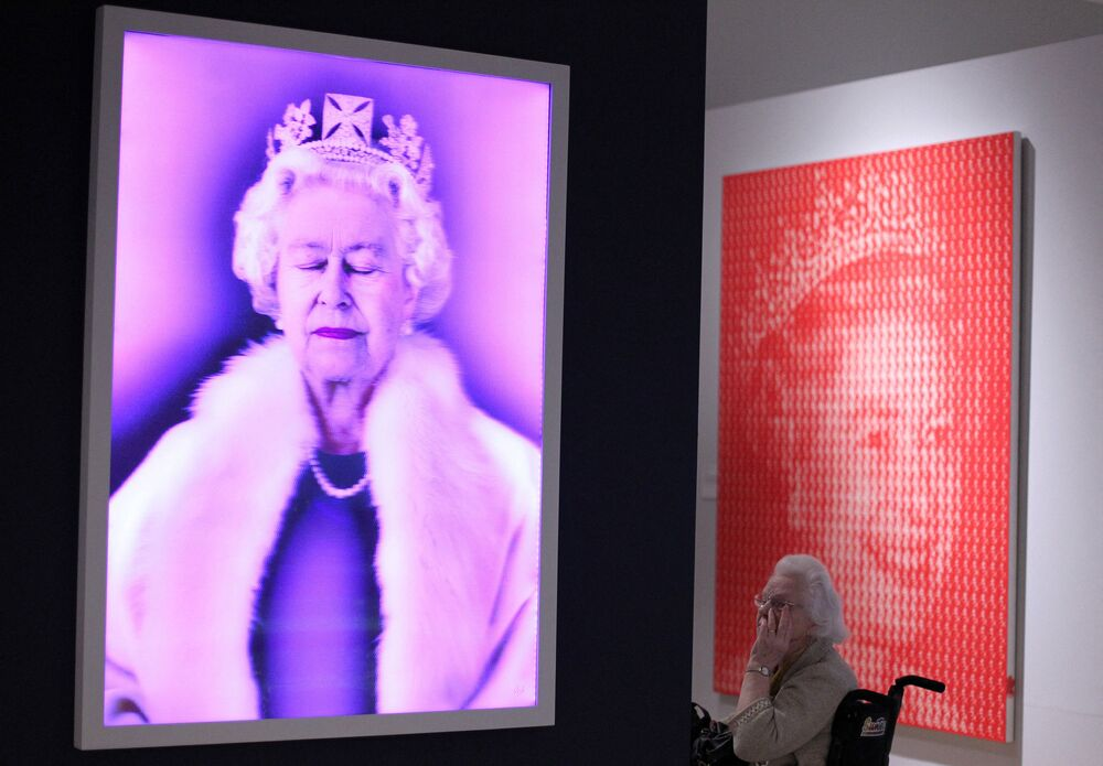 Lightness of Being inspired by the Queen (L) by Chris Levine and Kim Dong Yoo's painting Elizabeth II vs Diana (R) at Ulster Museum in Belfast, Northern Ireland in 2012.