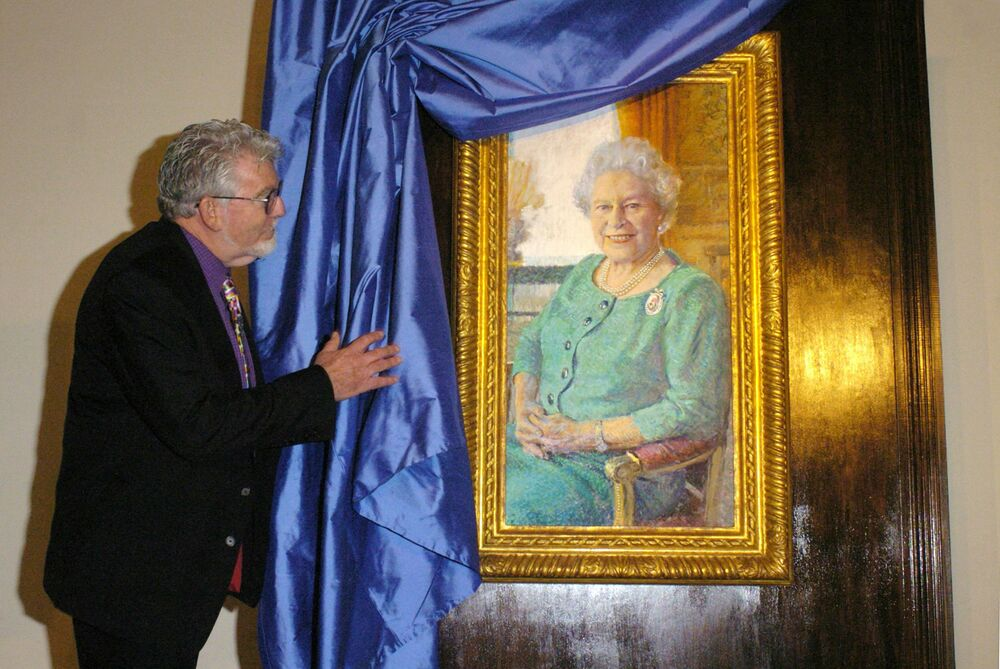 Australian artist Rolf Harris unveils his portrait of Britain's Queen Elizabeth II in the Queen's Gallery at Buckingham Palace in London in 2005. Harris painted the image to mark the Queen's 80th birthday.