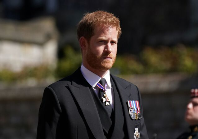 Britain's Prince Harry, Duke of Sussex looks on as he attends the funeral on 17 April 2021 of his grandfather Prince Philip, husband of Queen Elizabeth, who died at the age of 99 in Windsor, Britain.