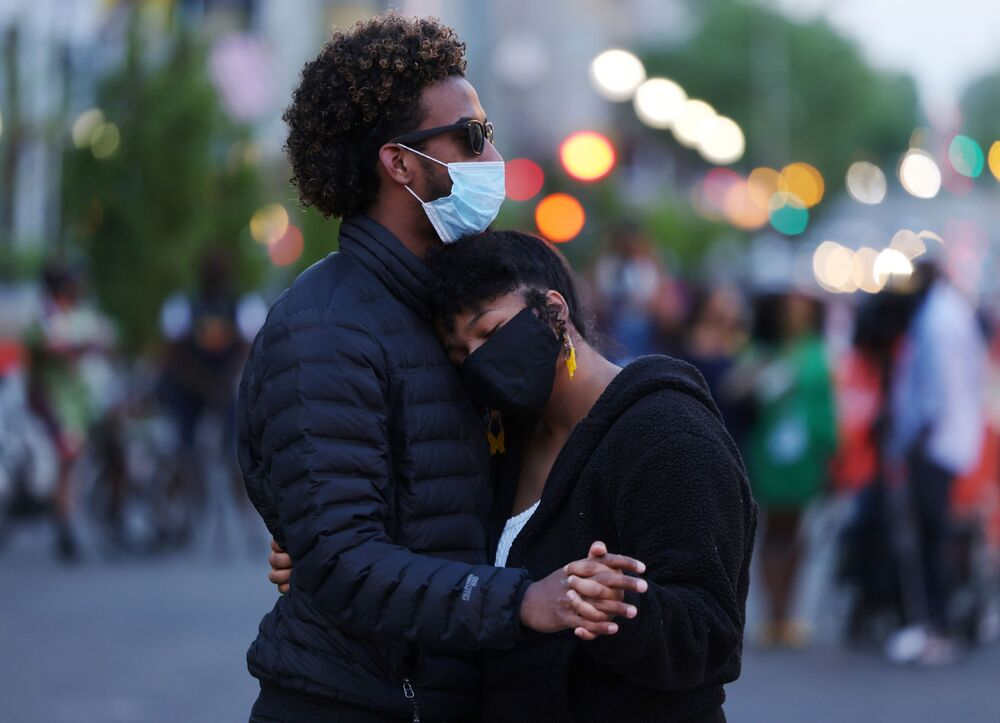 Xochitl Ramirez and Angel Reyes from Panama embrace following the verdict in the trial of former Minneapolis police officer Derek Chauvin, found guilty of the death of George Floyd, at BLM Plaza in Washington, D.C., US, 20 April 2021.