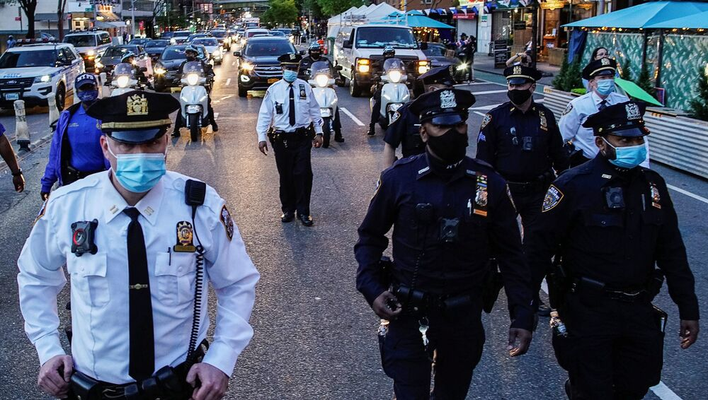 New York City Police Department (NYPD) personnel are seen on a road after the verdict in the trial of former Minneapolis police officer Derek Chauvin, found guilty of the death of George Floyd, in New York City, New York, US, 20 April 2021.