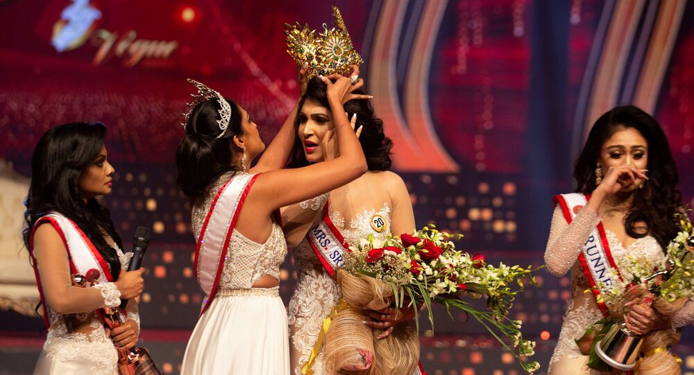 Reigning Mrs World Caroline Jurie, forcibly removes the Mrs Sri Lanka winner Pushpika De Silva's crown as Jurie declared that the winner was ineligible because she was divorced, during the Mrs Sri Lanka pageant, in Colombo, Sri Lanka April 4, 2021.