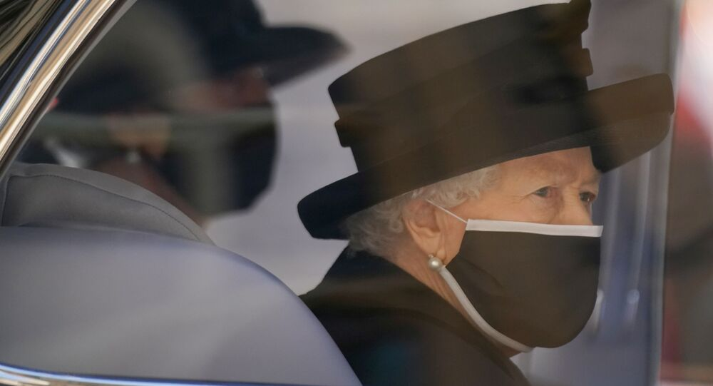 Britain's Queen Elizabeth II arrives for the funeral of Britain's Prince Philip, who died at the age of 99, at St George's Chapel, in Windsor, Britain, April 17, 2021.