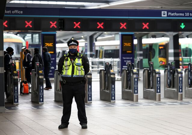 A police officer stands guard in front of closed platforms at London Bridge station after it was evacuated following a security alert, in London, Britain April 21, 2021