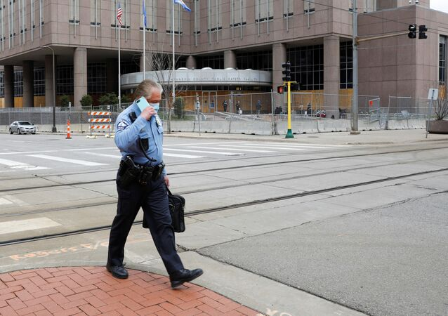 A Minneapolis police officer walks past the Hennepin County Public Safety Facility, during the trial of former police officer Derek Chauvin for the killing of George Floyd, and ongoing unrest following the killing of Daunte Wright by a police officer, in Minneapolis, Minnesota, U.S., April 14, 2021.