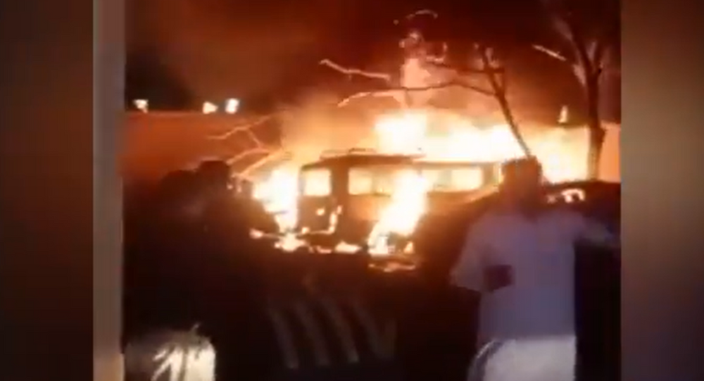 A screenshot from a video showing the aftermath of a blast that hit a parking lot at the Serena hotel in Pakistan