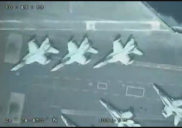 A screenshot from a video allegedly showing a US aircraft carrier took by an IRGC drone in the Persian Gulf
