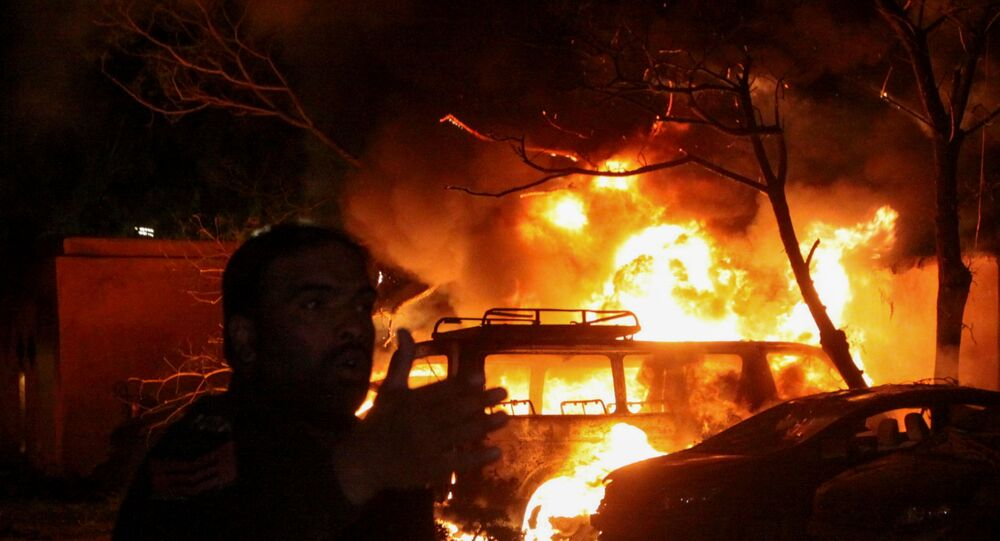 A police officer reacts after an explosion at a luxury hotel in Quetta, Pakistan April 21, 2021