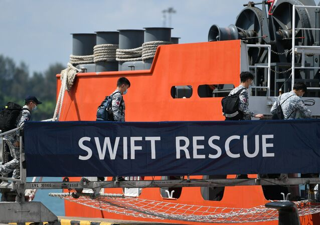 Officers board Singapore Navy's MV Swift Rescue ahead of rescue efforts for Indonesia's missing submarine KRI Nanggala-402, in Singapore April 21, 2021, in this image obtained from social media.