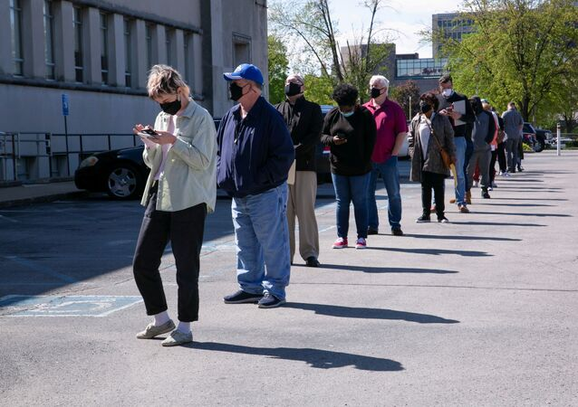 People line up outside a newly reopened career center for in-person appointments in Louisville, U.S., April 15, 2021