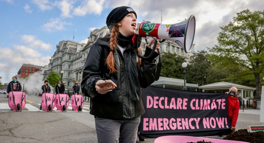 Extinction Rebellion DC blocks 17th Street after dumping cow manure outside the White House on Earth Day to protest President Biden's climate plan in Washington, U.S., April 22, 2021