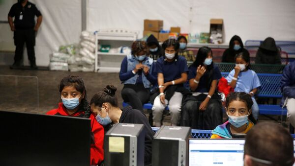 Young migrants get processed at the intake area of the Donna Department of Homeland Security holding facility, the main detention centre for unaccompanied children in the Rio Grande Valley, in Donna, Texas, Tuesday, March 30, 2021.  - Sputnik International