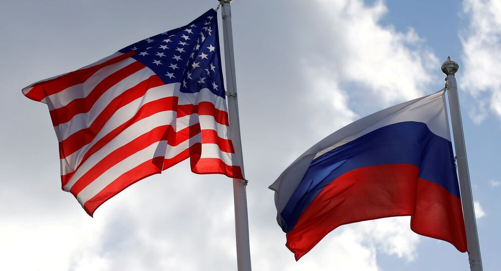 Russian and U.S. state flags fly near a factory in Vsevolozhsk, Leningrad Region, Russia March 27, 2019