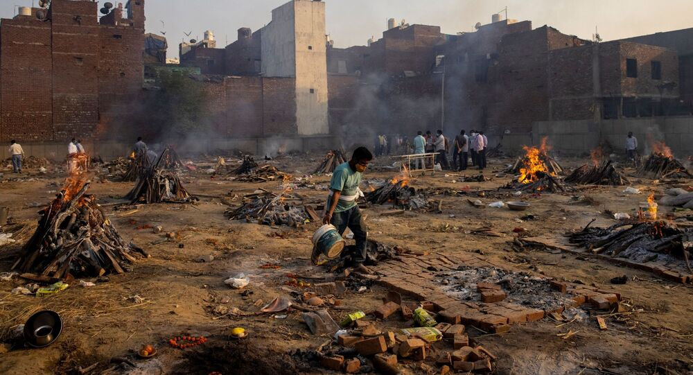 Funeral pyres of people, who died due to the coronavirus disease (COVID-19), are pictured at a crematorium ground in New Delhi, India, April 22, 2021