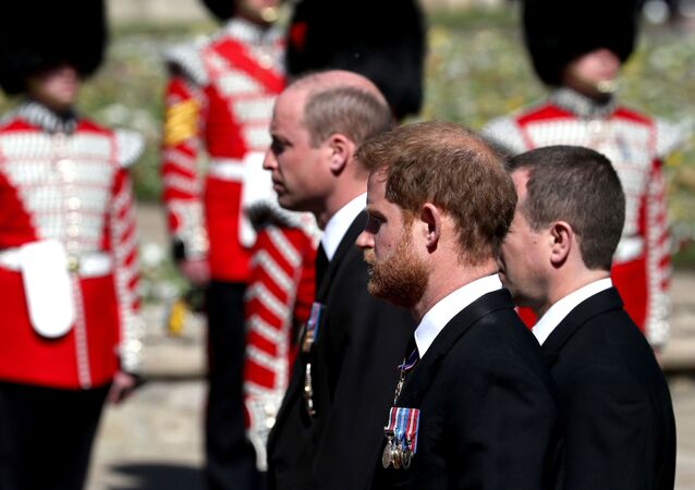 Britain's Prince William and Britain's Prince Harry follow the coffin of Britain's Prince Philip, as it passes through the Parade Ground, during his funeral at Windsor Castle, Britain, 17 April 2021