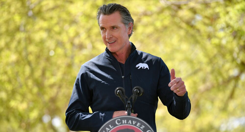 California Governor Gavin Newsom speaks during a visit by U.S. First Lady Jill Biden, at The Forty Acres, the first headquarters of the United Farm Workers labor union, in Delano, California, U.S. March 31, 2021.