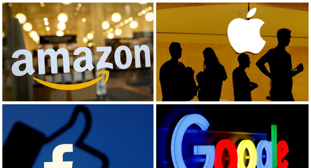 The logos of Amazon, Apple, Facebook and Google in a combination photo. File Photo