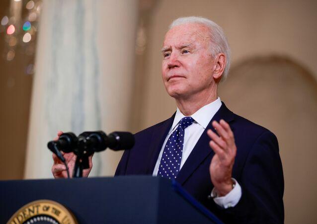 U.S. President Joe Biden speaks in the Cross Hall at the White House in Washington