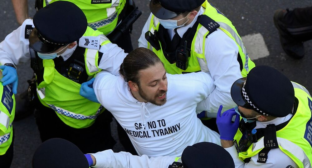 Police detain a demonstrator during an anti-lockdown 'Unite for Freedom' protest, amid the spread of the coronavirus disease (COVID-19), in London, Britain, April 24, 2021.