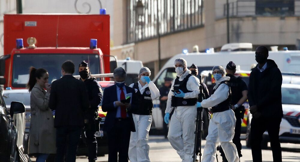 Police officers secure the area where an attacker stabbed a female police administrative worker, in Rambouillet, near Paris, France, 23 April 2021.
