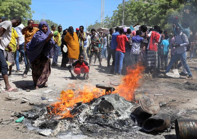 Protesters burn campaign pictures of Somalia's President Mohamed Abdullahi Mohamed on the streets of Yaqshid district of Mogadishu, Somalia 25 April 2021.