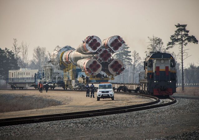 A Soyuz-2.1b rocket booster with a Fregat upper stage and satellites of British firm OneWeb is transported from a technical facility to a launch pad at the Vostochny Cosmodrome in Amur Region, Russia April 22, 2021.