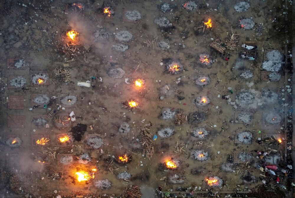 A mass cremation of victims who died from the coronavirus disease (COVID-19) is seen at a crematorium ground in New Delhi, India, 22 April 2021.