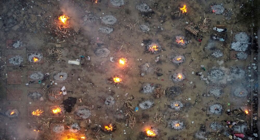 A mass cremation of victims who died due to the coronavirus disease (COVID-19), is seen at a crematorium ground in New Delhi, India, April 22, 2021