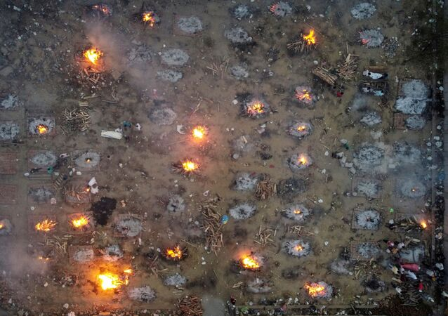 Mass cremation of victims who died from the coronavirus disease (COVID-19), is seen at a crematorium in New Delhi, India, 22 April 2021.