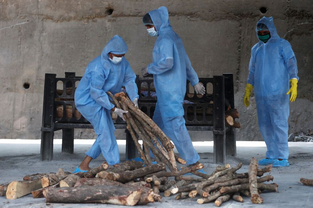 Frontline workers prepare the funeral pyre for a man who died from the coronavirus disease (COVID-19), at a crematorium on the outskirts of Mumbai, India, 15 April 2021.