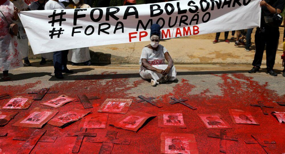 A demonstrator protests against Brazil's President Jair Bolsonaro and his handling of the coronavirus outbreak.