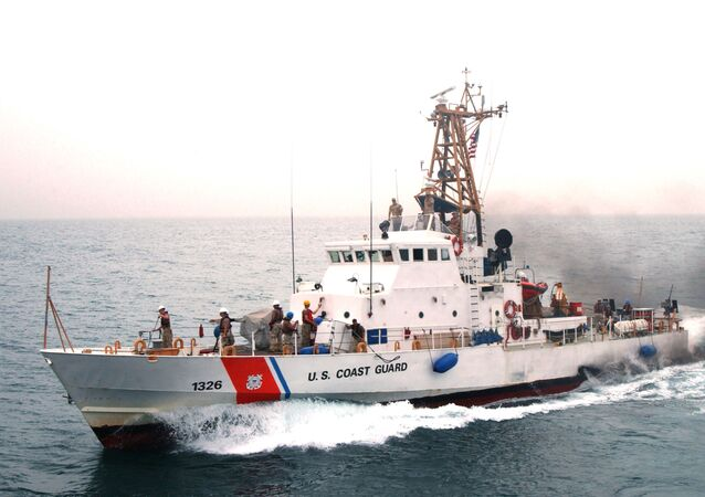 Coast Guardsmen aboard U.S Coast Guard Cutter Monomoy (WPB 1326) wave good-bye to the guided missile cruiser USS Antietam (CG 74) after the first underway fuel replenishment (UNREP) between a U.S. Navy cruiser and a U.S. Coast Guard Cutter.