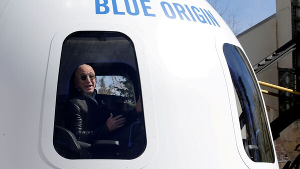 Amazon and Blue Origin founder Jeff Bezos addresses the media about the New Shepard rocket booster and Crew Capsule mockup at the 33rd Space Symposium in Colorado Springs, Colorado, United States April 5, 2017.  - Sputnik International