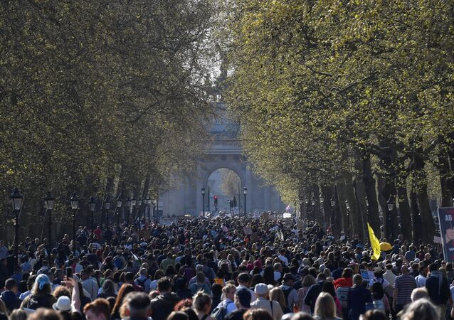 Demonstrators march during an anti-lockdown 'Unite for Freedom' protest, amid the spread of the coronavirus disease (COVID-19), in London, Britain, April 24, 2021