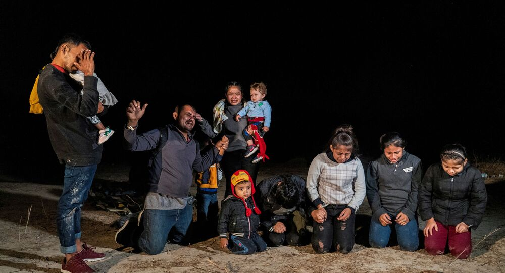 Asylum-seeking migrants' families from Guatemala pray the moment after crossing the Rio Grande river into the United States from Mexico in Roma, Texas, U.S., April 20, 2021. Picture taken April 20, 2021
