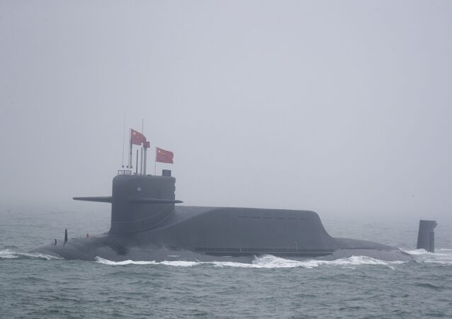 A new type 094A Jin-class nuclear submarine Long March 10 of the Chinese People's Liberation Army (PLA) Navy participates in a naval parade to commemorate the 70th anniversary of the founding of China's PLA Navy in the sea near Qingdao in eastern China's Shandong province, Tuesday, April 23, 2019