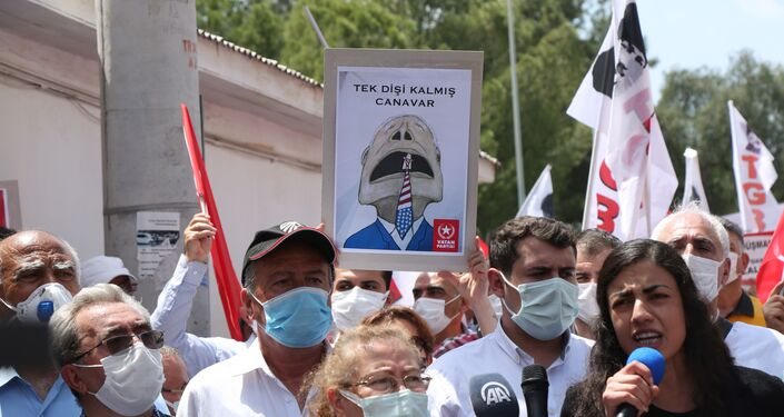 People protest outside Incirlik Air Base in Turkey, demanding to expel US troops stationed in it