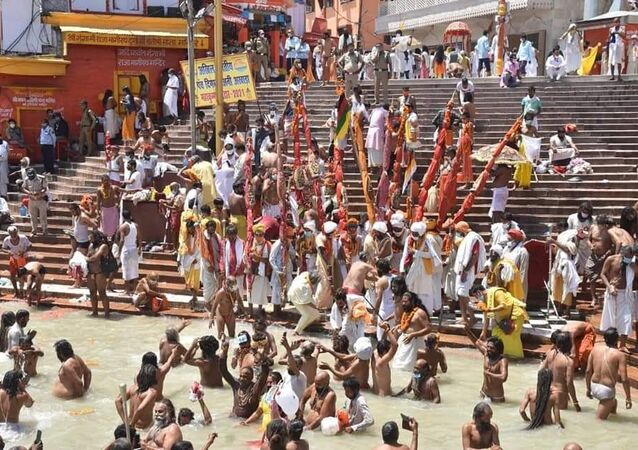 "Hundreds of Hindu devotees converged at the ""Har Ki Pauri"", the main river bank of the Ganges, in India's Haridwar city on Tuesday"