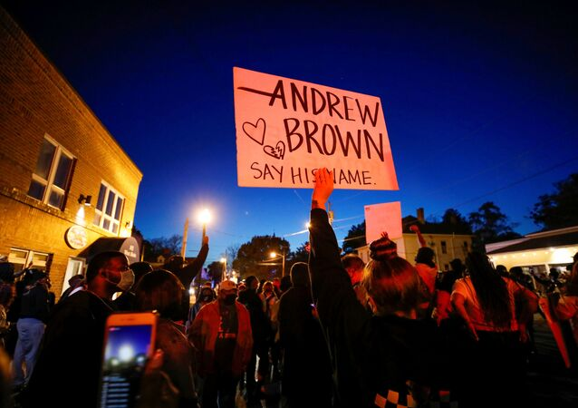 Protesters march in the evening after family members were shown body camera footage of a deputy sheriff shooting and killing Black suspect Andrew Brown Jr. last week, in Elizabeth City, North Carolina, U.S. April 26, 2021. Picture taken April 26, 2021.  REUTERS/Jonathan Drake