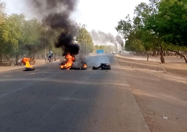 Tires burn at a fire barricade during protests demanding a return to civilian rule in N'Djamena, Chad 27 April 2021 in this still image obtained from social media video.