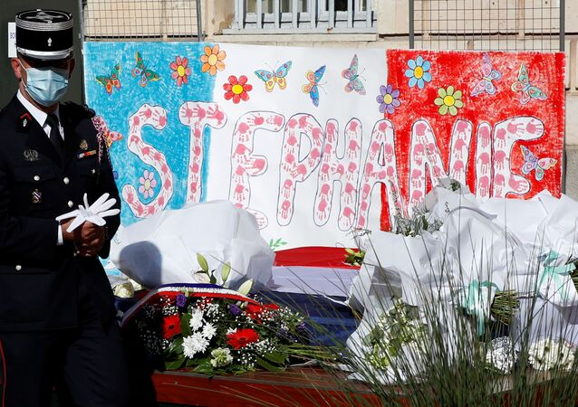 French police pay tribute to the police administrative worker, killed by a 36-year-old radicalised attacker last Friday, in front the city hall in Rambouillet near Paris, France, April 26, 2021