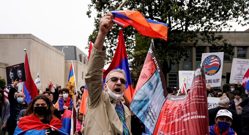 Members of the Armenian diaspora rally in front of the Turkish Embassy after U.S. President Joe Biden recognized that the 1915 massacres of Armenians in the Ottoman Empire constituted genocide in Washington, U.S., April 24, 2021.