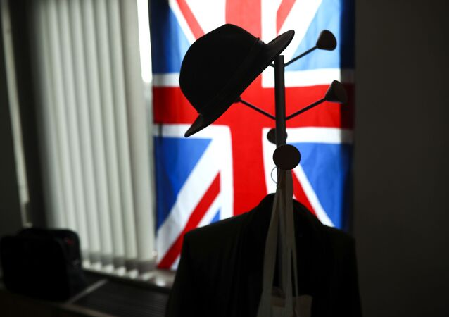 A hat hangs on a coat stand in front of the Union flag (File)