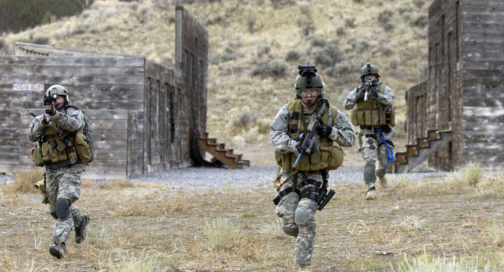 U.S. Army Soldiers from the 19th Special Forces, Utah National Guard conduct an urban village assault Nov. 13, 2007, at Camp Williams, Utah, during an extraction of a simulated downed pilot as a part of a Combat Search and Rescue (CSAR) Integration exercise.